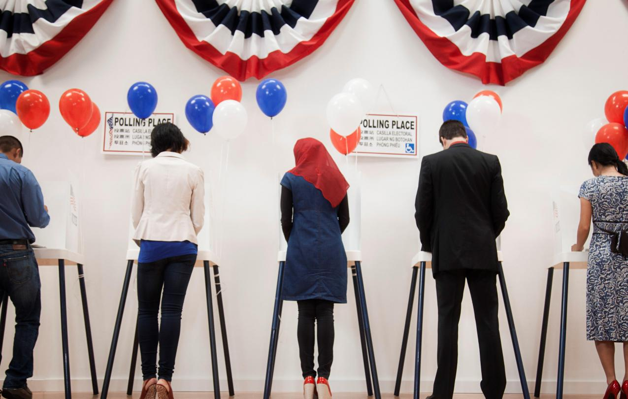 Five people at the voting boxes